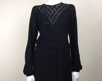 black nubby knit sweater dress w/ beaded openwork & bishop sleeves 70s