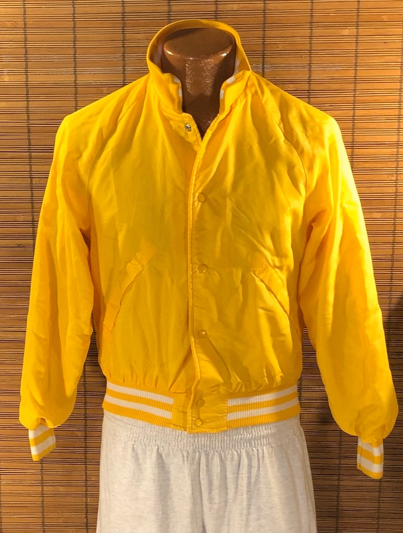 18-20 Cuckoo\u2019s Nest Baseball Type Jacket Terrific yellow color Fun graphics on the back Vintage 1980\u2019s Youth XL 6 snap closures on the