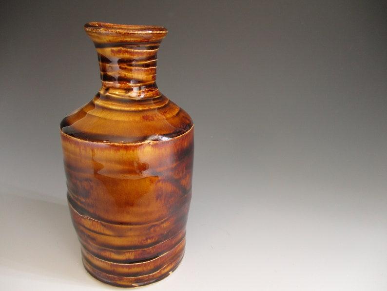 1 Amber Bottle Vase