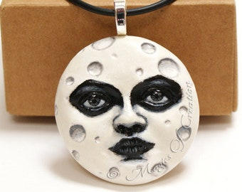 White full moon pendant, unique moon lover gift! Hand painted cast sculpture realized as an elegant black and white necklace!