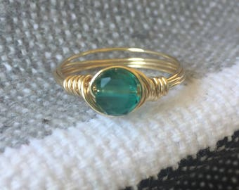 Ring size 6.25 - teal bead with gold tone wire
