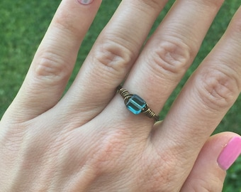 Ring size 7.25 - teal bead with brass tone wire