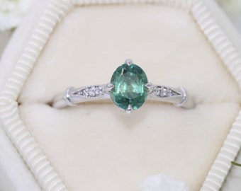 Oval Teal Montana Sapphire Ring with Vintage Inspired Mill Grain Details