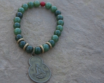 Green Jade beaded bracelet with bronze Quan Yin charm and red accent bead