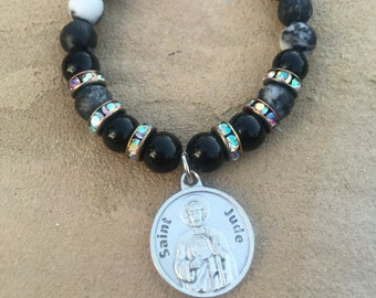 Black and White beaded bracelet with silver Saint Jude charm