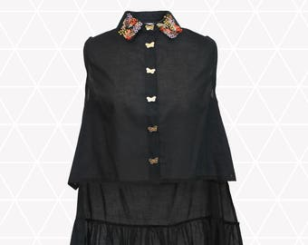 Asymmetric shirt with bead embroidery and moth shaped buttons