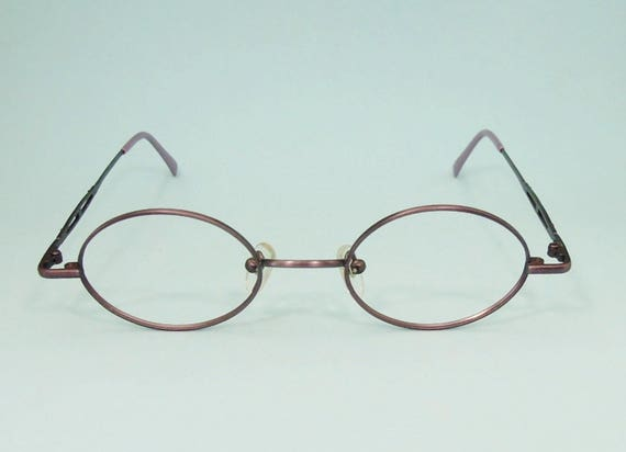 75183598b7 Exclusive Eyeglass Frame Oval Lens Shape Metal Size