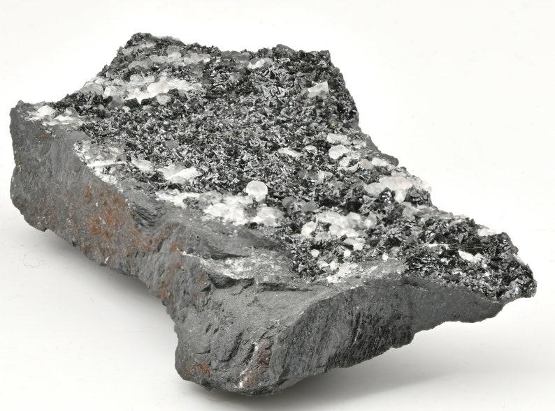 Wonderful Lustrous Hausmannite Crystals With Calcite On Hematite Matrix