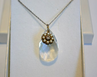 Gorgeous Swarovski crystal with intricate pearl charm and sterling silver necklace