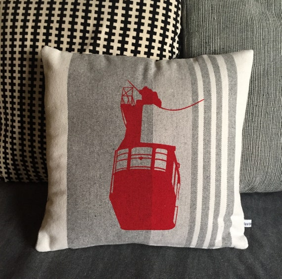 pillows with red cable car