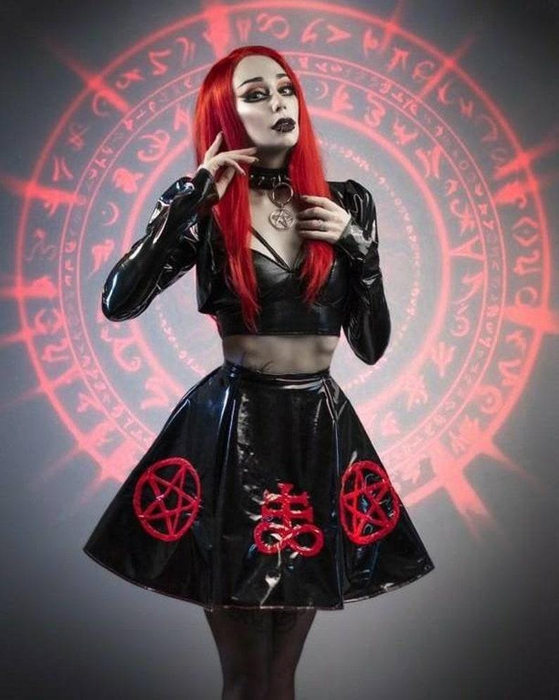 e26407e481c06 Black PVC fetish gothic skater skirt with satanic symbols.