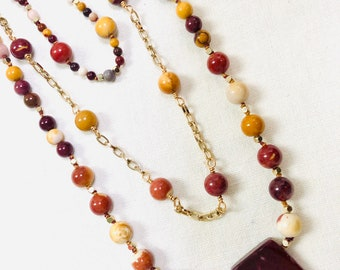 Red and yellow mookaite inverted drop stone wire wrapped pendant in raw brass with an 18 petite brass ball chain necklace