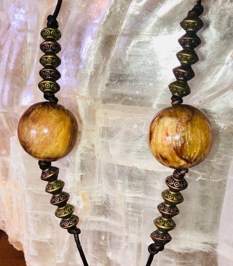 Boho Style Long Adjustable Necklace with a Focal Dzi Style Green /& Bronze Bead with a Gold Tone Beaded Tassle on Dark Brown Natural Leather