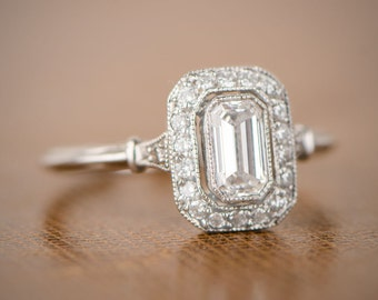 0.50-Carat Vintage Style Emerald Cut Diamond and Diamond Halo Ring (0.66-Carat Total Weight)