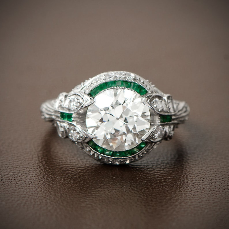 Rare and Pristine Art Deco Style Engagement Ring , Emerald and Diamond Halo  , Bow Motif