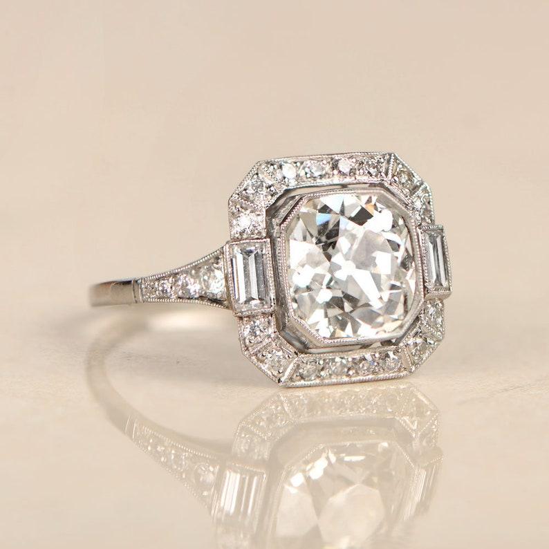 ca6306229dd3c 2.48 Carat Antique Cushion Cut and Diamond Halo Platinum Ring