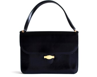 Classic vintage Christian Dior black leather handbag with top handle