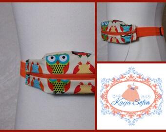 Bright owls insulin pump belt with orange elastic.  Size 2.