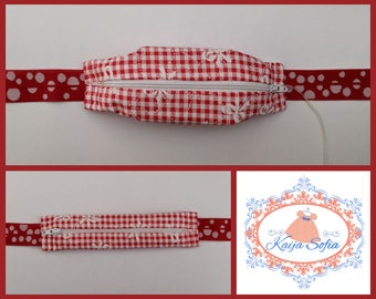 Red gingham with bows insulin pump belt with white and red spotty elastic.  Size 2.