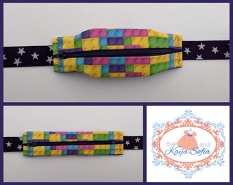Colourful bricks insulin pump belt with purple and white star elastic. Size 1 (age 2 - approximately age 9).