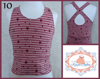 Insulin pump crop top to fit approximately age 10.  Pink fabric with stripes and stars.