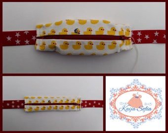 Duck print insulin pump belt with red and white starry elastic.  Size 2.