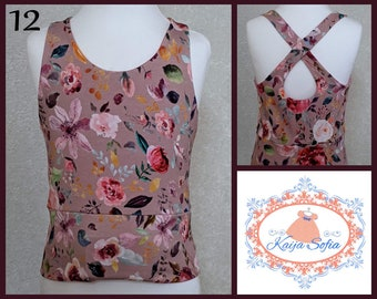 Insulin pump crop top to fit approximately age 12.  Pink floral print fabric.