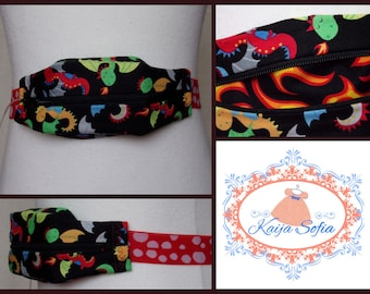 Baby dragons insulin pump belt with flames lining and red and white spots elastic. Size 1 (age 2 - approximately age 9).