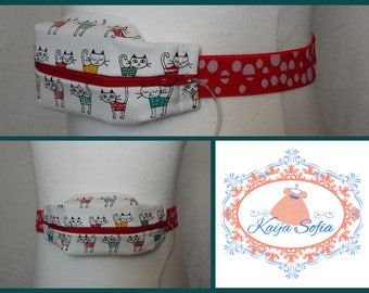 Multicoloured sketched cats on cream insulin pump belt with red and white spotty elastic.  Size 2.