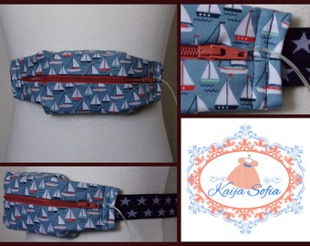 Boats on blue insulin pump belt with navy blue and white star elastic. Size 1 (age 2 - approximately age 9).