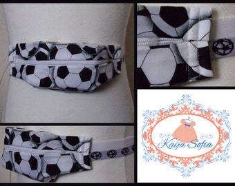 Black and white footballs insulin pump belt with matching elastic. Size 1 (age 2 - approximately age 9).
