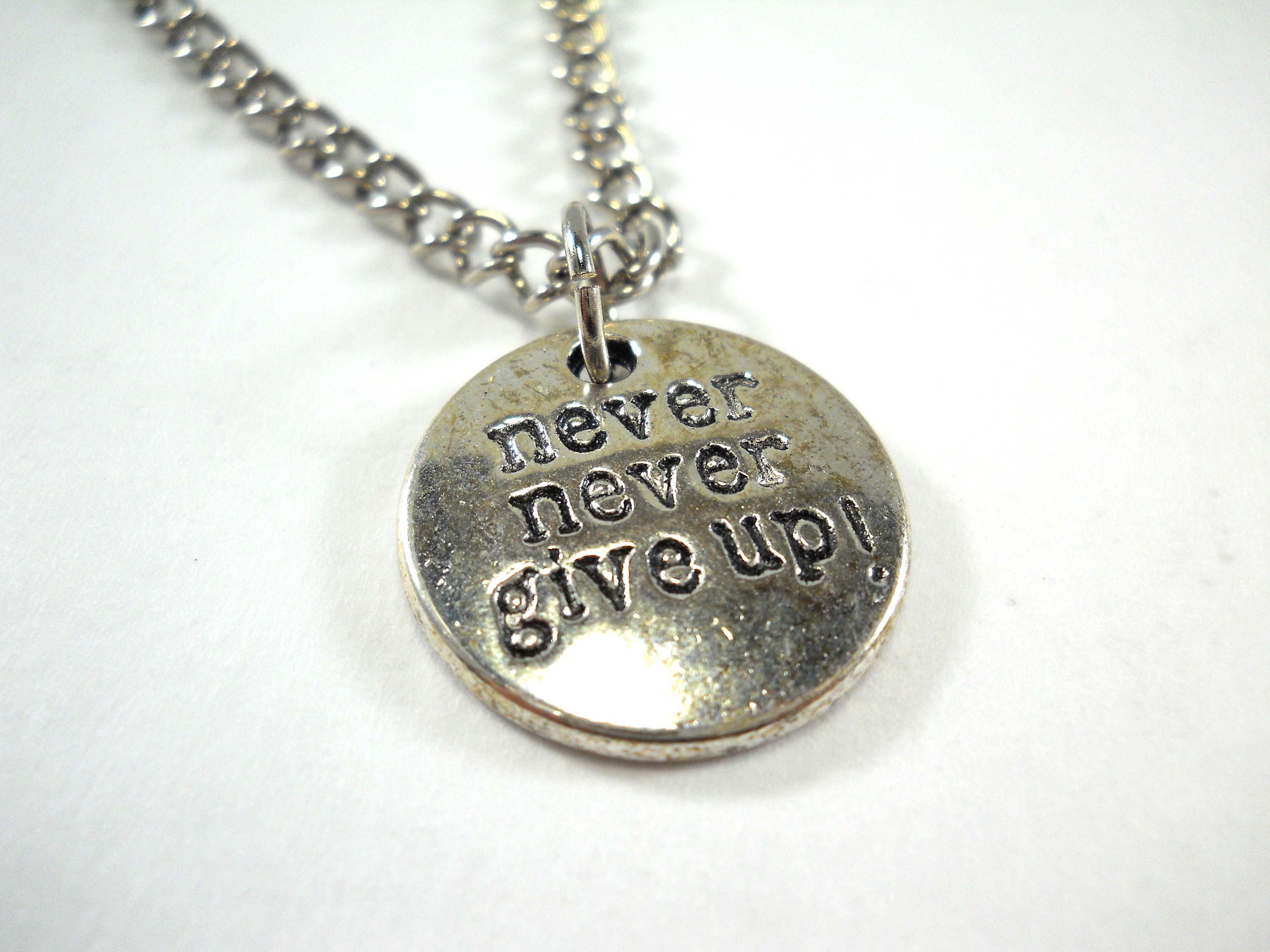 Never never give up charm pendant necklace antique silver tone gallery photo gallery photo gallery photo aloadofball Images