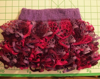 Baby or toddler ruffled skirt. Pink and purples.