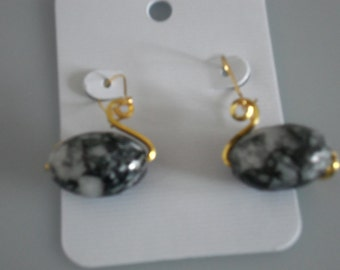 Wire wrapped bead dangle earrings. Swan shaped using black and grey bead and gold fine silver  plated  copper wire.