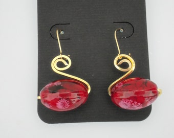 Wire wrapped bead dangle earrings. Swan shaped  using red/black bead and gold fine silver plated copper wire.