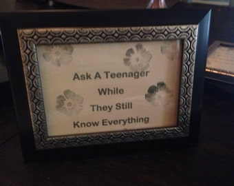 "Sign ""Ask a teenager while they still know everything..."" black & gold frame"