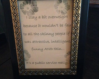 "Sign ""I stay a bit overweight..."" black & gold frame"