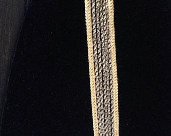 """Monet vintage gold toned 7 strand bracelet!  7"""""""