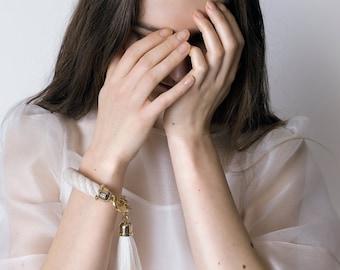 SIRIUS cuff statement bracelet. Cream color silk ivory tassels. statement jewelry. bold accessories. minimalist. rope bracelet. bold jewelry
