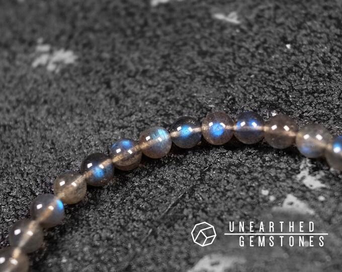 6mm Blue Flash Black Labradorite Bracelet