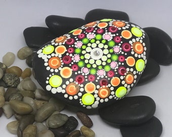 Rocks painted and adorned with Swarovski crystals.