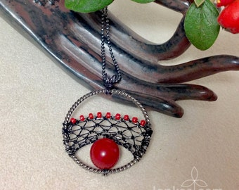 Red Fruit Pendant, Black Silk and Steel Wire, Red Coral and Seed Beads ~ handmade needle lace in round frame - fulfilment of natural cycle