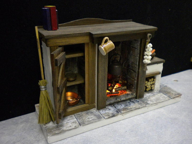 Doll House Fireplace with opening cupboard door and light up image 0