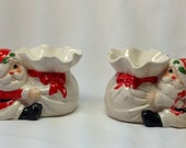 Vintage Fitz Floyd FF Santa Clause Hugging Sack Figurine Christmas Holiday Taper Candle Candlestick Holder Porcelain Set Red Bow Holly Pair
