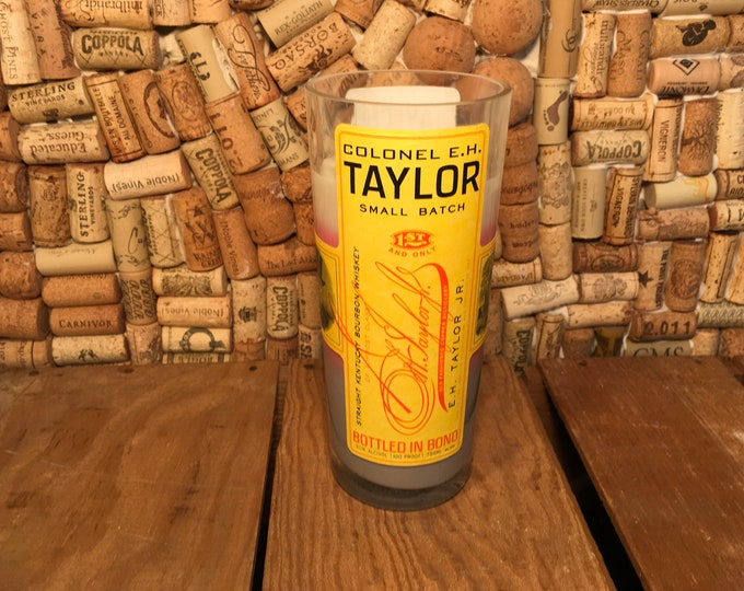 Triple layered candle in a Colonel Taylor Whiskey Bottle