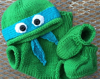 f9d246ed9e6 Hand-knit teenage mutant ninja turtle hat with booties and diaper soaker  cover. COWABUNGA!