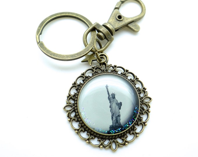 Bag charms / keyrings CD55 feather to the ear in resin and brass bracket