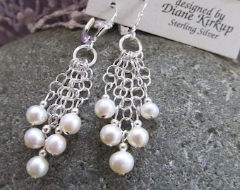 A Cascade of Fresh Water White Pearls Dropping From Sterling Silver Chains - Presented On Sterling Silver Lever Back Findings - White Pearls