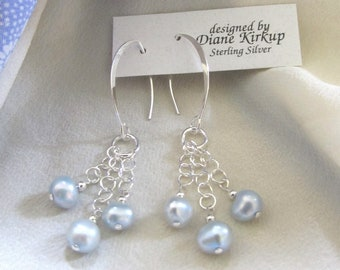 Soft Baby Blue Fresh Water Pearl Earrings . Three Pearls Drop From Sterling Silver Chains In A Balanced Fashion . Sterling Silver Findings