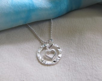 """Hammered Sterling Silver Circle With Small Sterling Silver Open Heart Suspended In The Middle - Presented On An 18"""" Sterling Silver Chain"""
